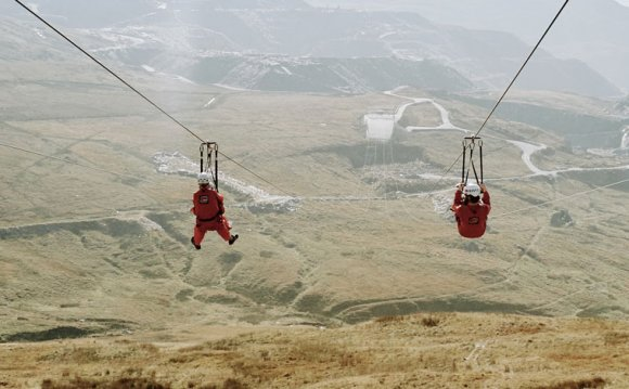 Four people on zip wires at