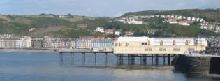 Image of Aberyswtyth shore, on this page you are able to explore Aberystwyth accommodation, places to see and occasions