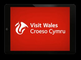 Visit Wales logo white on red